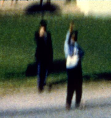 """Dark Complected Man"" and ""Umbrella Man"" in Dealey Plaza"