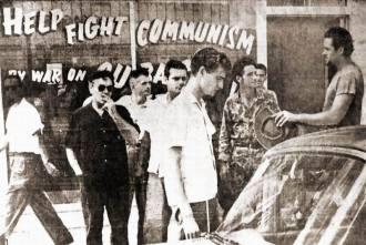 Larry de Joseph (black shirt), Frank Sturgis (center) and Gerry Hemming (right)
