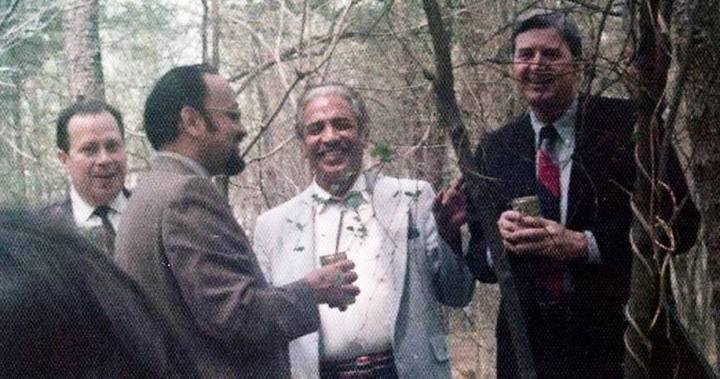 David Morales (center) with Thomas Clines (right) at Langley, toasting the death of Che Guevara