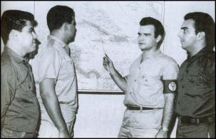 Rafael Quintero (right) and Manuel Artime (with pointer)