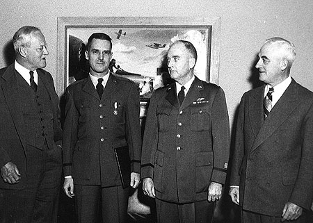 Ed Lansdale (second from left)