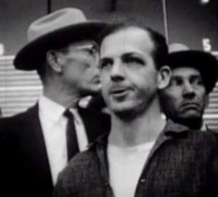 Oswald, the moment he first hears that he has been charged with killing JFK