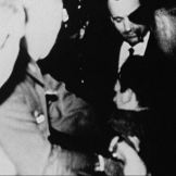 Oswald being arrested; Credit: Bart Kamp