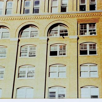 One of the several color photos purchased by researcher Art Kimbrough in the 1960's from the photographer who took them. DPD officer Gerald Hill is visible in a 6th floor window. Credit: Denis Morissette