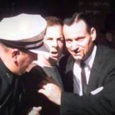 Oswald arrested by Patrolman C.T. Walker and Detective Paul Bentley