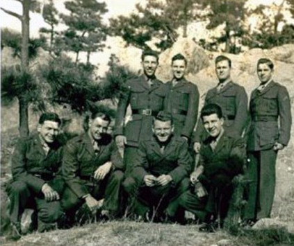 Robert Emmett Johnson (far right, standing)